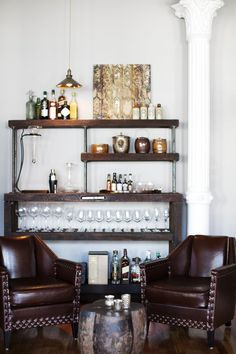 Amazing architectural details and great bones call to be enhanced with rich industrial finds mixed with eclectic, modern touches. A pair of leather chairs is a cozy spot to enjoy conversation and drinks from the rustic bar.