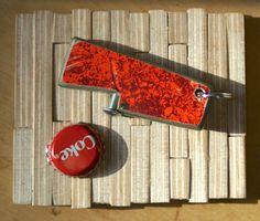 repurposed skateboard bottle opener keychain. $12.00, via Etsy.