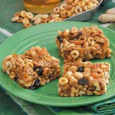 Double Peanut Bars Recipe -These sweet no-bake snacks are great energy bars. Any dried fruit works well, but I prefer cranberries. Grain cereals, plus honey, peanuts and peanut butter make the bars popular at my house.                                 -Kim Rocker of LaGrange, Georgia