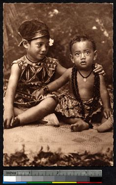 Two Samoan children sitting on a mat, Samoa, ca.1900-1930  digitallibrary.usc.edu
