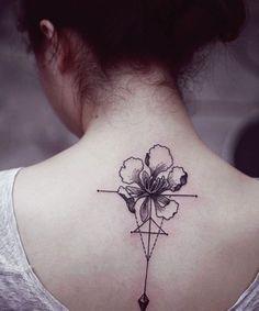 Elegant flower tattoo on back