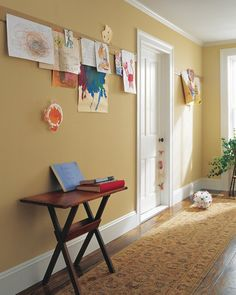 I love the idea of hanging the kids art down the hall of our house- this is definitely going to be one of our next projects!