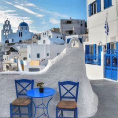 Two spirits Two chairs Two o clock And the sun is shining on us know #pyrgos #kyklades #greece .