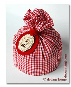 Door stop - use some fabric that matches your decor, some sand and decorate however you wish... tutorial
