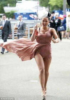 Royal Ascot race-goer has dress blown up by wind