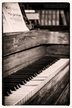 Long Ago Black and White Photo of Piano in Library