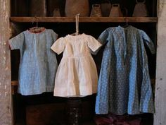 Early blue calico doll dresses