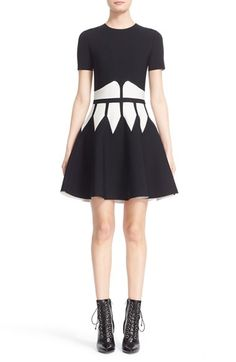 Free shipping and returns on Alexander McQueen Intarsia Knit Fit & Flare Dress at Nordstrom.com. Contrast intarsia panes accentuate the trim waist and buoyant flare of a structural circle-skirt dress in a dense Italian stretch knit.