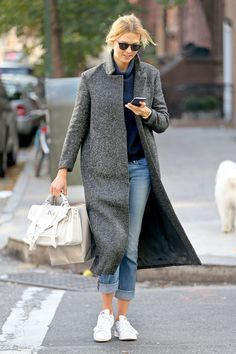 Blue turtleneck jumper + grey coat + jeans and white trainers