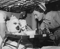 This photo was taken aboard the USS Repose, this time on Thanksgiving Day 1952 in Incheon, South Korea. Pictured above is LTJG Weece Wood of the US Navy Nurse Corps with Private first class (PFC) Jack Newman. Despite the difficult circumstances of war and the stressful conditions, Wood is shown spreading joy and cheer. There was a general shortage of qualified nurses during the Korean War, so the Navy swelled its ranks by calling on reserve nurses from WWII.