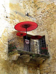 Balcony window with red umbrella