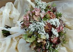 Beautifully mottled hydrangeas and Upper Secret roses look beautifully old-fashioned.