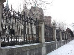 The scrolled iron gate around the American Swedish Institute