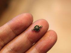 20 pcs - antique brass - cute little sunflower charms connectors - solid 3D - 6 x 10mm. $1.95, via Etsy.