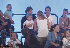 Mirka and her twin boys and twin girls at tennis match