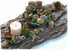 Winter table scape w pinecones and candles