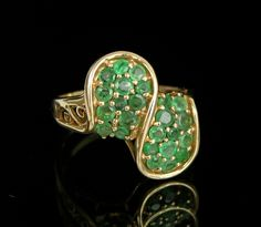 An Emerald Cluster Gold Ring
