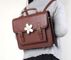 Color: brown, black Bag dimensions: 31cm * 26cm * 7cm  More Products:http://www.storenvy.com/stores/128554-fashion-store