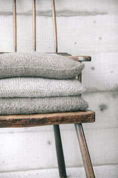 Shades of grey. From Cereal magazine volume 2 Photo by Rich Stapleton Wabi Sabi, Magazine Cereal, Textiles, Knitted Cushions, Chair Cushions, Grey Cushions, Knitted Cushion Covers, Wool Pillows, Floor Cushions
