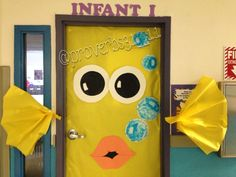Yellow fish classroom door made with butcher paper, paper plates, and paint.