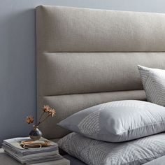 Love this modern update to the tufted headboard.  Top Ten: Best Upholstered Fabric Headboards