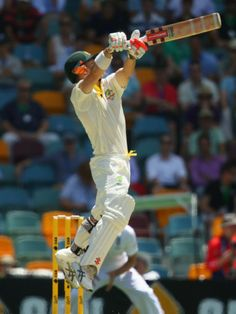 David Warner hits an uppercut off Stuart Broad - David Warner of Australia bats during day one of the First Ashes Test match between Australia and England at The Gabba on November 21, 2013 in Brisbane, Australia.  Getty Images: Mark Kolbe