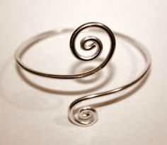 Handmade  arm band ,spiral shape made of brass, aluminium, copper, german silver wire or sterling silver 925.