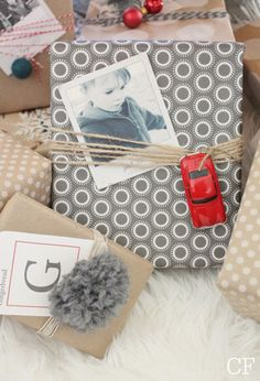 Use Polaroids to decorate Christmas gifts.
