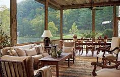 I love this beautiful porch - so inviting.....   fishing cabins