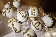 Football and Chanel Cake pops from Sweet Lauren Cakes  www.sweetlaurencakes.com
