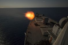 MEDITERRANEAN SEA  (Sept. 11, 2016) A MK 45 5-inch lightweight gun aboard USS Carney (DDG 64) fires at night while on patrol in the Mediterranean Sea. Carney, an Arleigh Burke-class guided-missile destroyer, forward-deployed to Rota, Spain, is conducting a routine patrol in the U.S. 6th fleet area of operations in support of U.S. national security interests in Europe. (U.S. Navy photo by Mass Communication Specialist 3rd Class Weston Jones/Released)