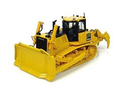 This Komatsu D155 AX Dozer Diecast Model Tractor is Yellow and features working blade, tracks. It is made by Universal Hobbies and is 1:50 scale (approx. 16cm / 6.3in long).  ...