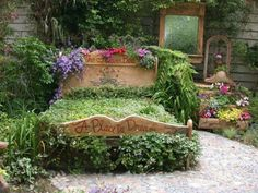 Bed of flowers...maybe instead of a bed, i will fill my old sleigh bed with flowers!! On top and on the sides!!