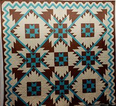 Southwest Mountains Quilt Pattern done in brown/turquoise/cream