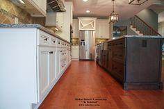 Two-Tone Color Scheme in the kitchen of the Bodaford. #michaelrobertsconstruction #customhomebuilder #coastalgeorgia #richmondhillga #kitchen