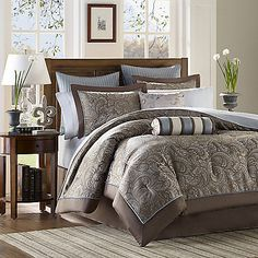 Classically styled with a timeless paisley print, this gorgeous comforter set brings designer style to your bedroom. Cool shades of blue and warm shades of mocha mix and mingle in paisley patterns with coordinating stripes.