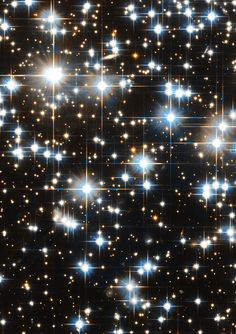 This image of globular cluster NGC 6397 in the constellation Ara (the Altar) was taken by the NASA/ESA Hubble Space Telescope. The cluster is home to a highly unusual system consisting of a fast spinning pulsar and a bloated red companion star. Cosmos, Globular Cluster, Dark Galaxy, Hubble Images, Hubble Space Telescope, Telescope Images, Star Cluster, All Nature, Star Formation