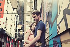 Engagement shoot with a wonderful graffiti wall (photo by Marshal Gray Photography)