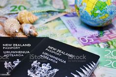 New Zealand Passport with NZD New Zealand Dollars A current New Zealand Passport its on top of a background of New Zealand Dollar Bank Notes. All Australasian Currencies Stock Photo Bank Financial, New Zealand Dollar, New Passport, Video New, Photo Illustration, Image Now, Royalty Free Images, Notes