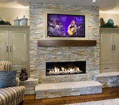 fireplaces with tv | Linear fireplace with a flat screen TV on top/ by Pahlisch Homes