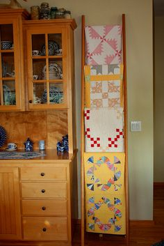Antique quilts on a vertical ladder.  Probably my favorite display method so far.