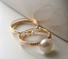 Freshwater pearl wrapped in gold filled wire. This is a matching set, so you get two rings. Set of Gold Pearl Rings Freshwater pearls wire-wrapped stacking rings --- have some pearls from my Dad when he was in Korea . Wire Jewelry Designs, Handmade Wire Jewelry, Diy Jewelry, Beaded Jewelry, Jewelry Making, Jewellery, Handmade Rings, Stylish Jewelry, Jewelry Patterns