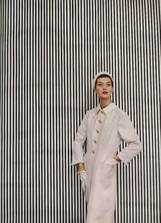 Barbara Mullen, February Vogue 1952    Barb is wearing a coat of creamy-white Italian silk by Hattie Carnegie.    photo Richard Avedon