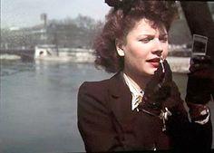 Woman-applying-lipstick-Paris-WWII-Andre-Zucca