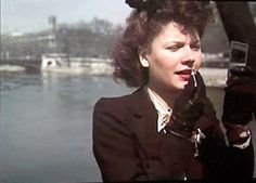 Woman-applying-lipstick-Paris-WWII-Andre-Zucca