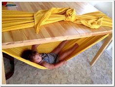 Under table hammock! Kids would love this!  A few tips: I used full/queen size sheets. Had to tie around the width of the table not the length. I had to tie them by matching diagonal corners. You have to fold them a certain way to make it work but they're having fun and so far no one has fallen out.