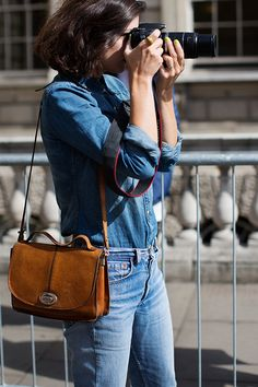 I don't love this denim-on-denim trend, but her shirt, nails, & bag are all good by me!