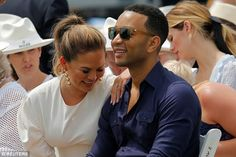 Giggle-fest: Chrissy enjoyed a laugh with her man during the tennis match...