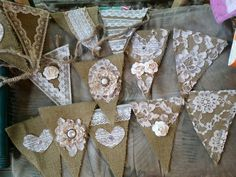 Bunting style garland made by Leila Bee Designs. Burlap, vintage lace and vintage buttons.