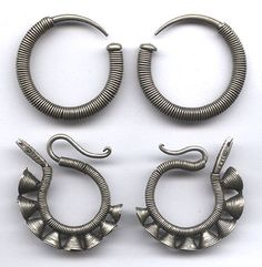 Two pairs of Miao South China base metal hoops  with lots of coiled wire.